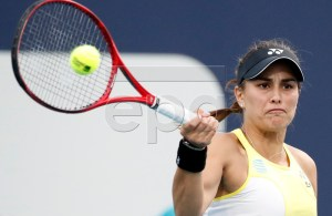 Monica Puig of Puerto Rico in action against Xiyu Wang of China during their match at the Miami Open tennis tournament in Miami, Florida, USA, 20 March 2019. EPA-EFE/JASON SZENES