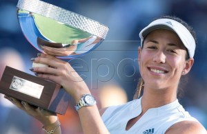 Spanish tennis player Garbine Muguruza poses with the trophy after defeating Victoria Azarenka of Belarus during their women's singles final match at the Monterrey Open tennis tournament in Monterrey, Mexico, 07 April 2019. EPA-EFE/MIGUEL SIERRA