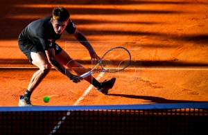 Alex de Minaur of Australia in action against Joao Domingues of Portugal during their first round match at the Estoril Open tennis tournament in Cascais, near Lisbon, Portugal, 29 April 2019. EPA-EFE/JOSE SENA GOULAO