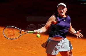 Jelena Ostapenko of Latvia in action against Kiki Bertens of the Netherlands during their second round match of the Mutua Madrid Open tennis tournament at the Arantxa Sanchez court of the Caja Magica in Madrid, Spain, 06 May 2019. EPA-EFE/CHEMA MOYA
