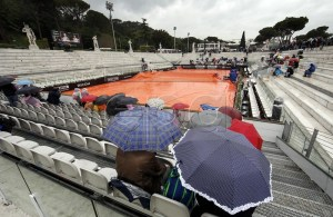 Spectators sit under umbrellas as all the matches are suspended due to rain at the Italian Open tennis tournament in Rome, Italy, 15 May 2019. EPA-EFE/Riccardo Antimiani