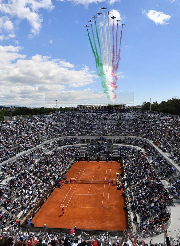 The Frecce Tricolori air squadron flies over the Foro Italico as Serbia's Novak Djokovic plays against Canada's Denis Shapovalov during their ATP Masters tournament tennis match in Rome, Italy, 16 May 2019.  EPA-EFE/ETTORE FERRARI