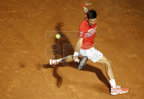 Novak Djokovic of Serbia in action against Diego Schwartzman of Argentina during their men's semifinal match at the Italian Open tennis tournament in Rome, Italy, 18 May 2019. EPA-EFE/RICCARDO ANTIMIANI