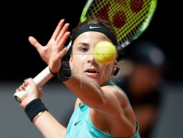 Belinda Bencic of Switzerland in action against Mandy Minella of Luxembourg during their first round match at the Porsche Tennis Grand Prix tournament in Stuttgart, Germany, 24 April 2019.  EPA-EFE/RONALD WITTEK