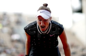 Marketa Vondrousova of the Czech Republic reacts as she plays Petra Martic of Croatia during their women?s quarter final match during the French Open tennis tournament at Roland Garros in Paris, France, 04 June 2019. EPA-EFE/YOAN VALAT
