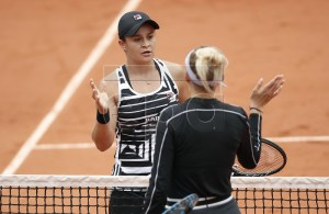 Ashleigh Barty of Australia (L) react with Amanda Anisimova of the USA after winning their women?s semi final match during the French Open tennis tournament at Roland Garros in Paris, France, 07 June 2019. EPA-EFE/YOAN VALAT