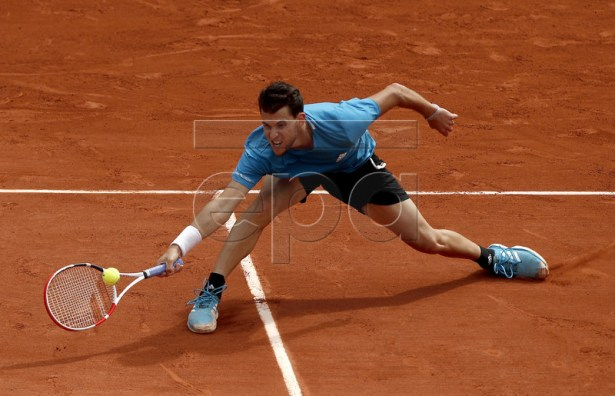 Dominic Thiem of Austria plays Rafael Nadal of Spain during their men?s final match during the French Open tennis tournament at Roland Garros in Paris, France, 09 June 2019. EPA-EFE/YOAN VALAT