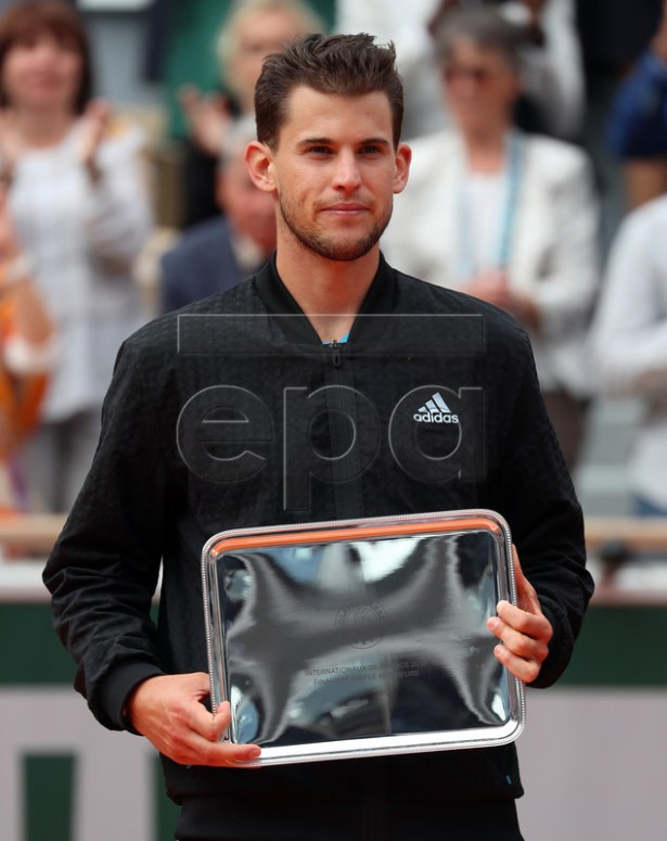 Dominic Thiem of Austria poses with the runner-up trophy after losing the men?s final against Rafael Nadal of Spain match during the French Open tennis tournament at Roland Garros in Paris, France, 09 June 2019. EPA-EFE/SRDJAN SUKI
