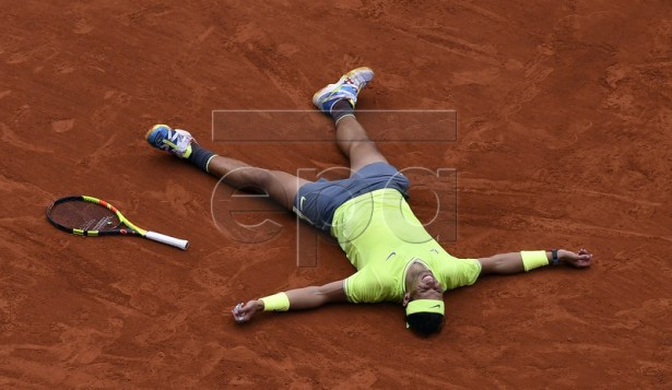 Rafael Nadal of Spain reacts after winning the men?s final match against Dominic Thiem of Austria during the French Open tennis tournament at Roland Garros in Paris, France, 09 June 2019. Nadal won the French Open title 12th times.  EPA-EFE/JULIEN DE ROSA
