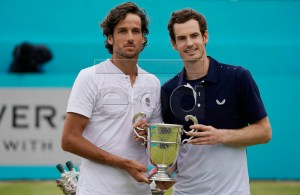 Britain's Andy Murray and Feliciano Lopez of Spain lift the championship trophy after winning their mens doubles final against Britain's Joe Salisbury and Rajeev Ram at the Fever Tree Championship at Queen's Club in London, Britain, 23 June 2019. EPA-EFE/WILL OLIVER