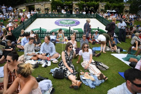 Spectators on the grounds on day three of the Wimbledon Championships at the All England Lawn Tennis Club, in London, Britain, 03 July 2019. EPA-EFE/ANDY RAIN EDITORIAL USE ONLY/NO COMMERCIAL SALES