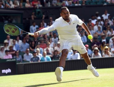 Nick Kyrgios of Australia returns to Rafael Nadal of Spain in their second round match during the Wimbledon Championships at the All England Lawn Tennis Club, in London, Britain, 04 July 2019. EPA-EFE/FACUNDO ARRIZABALAGA EDITORIAL USE ONLY/NO COMMERCIAL SALES