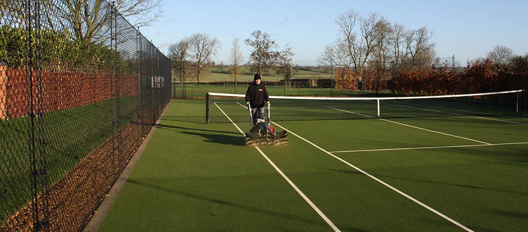 Brushing deters moss growth on a tennis court