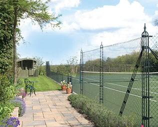 Pladek tennis court in green by En Tout Cas
