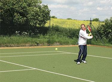Savanna tennis court surface by En Tout Cas