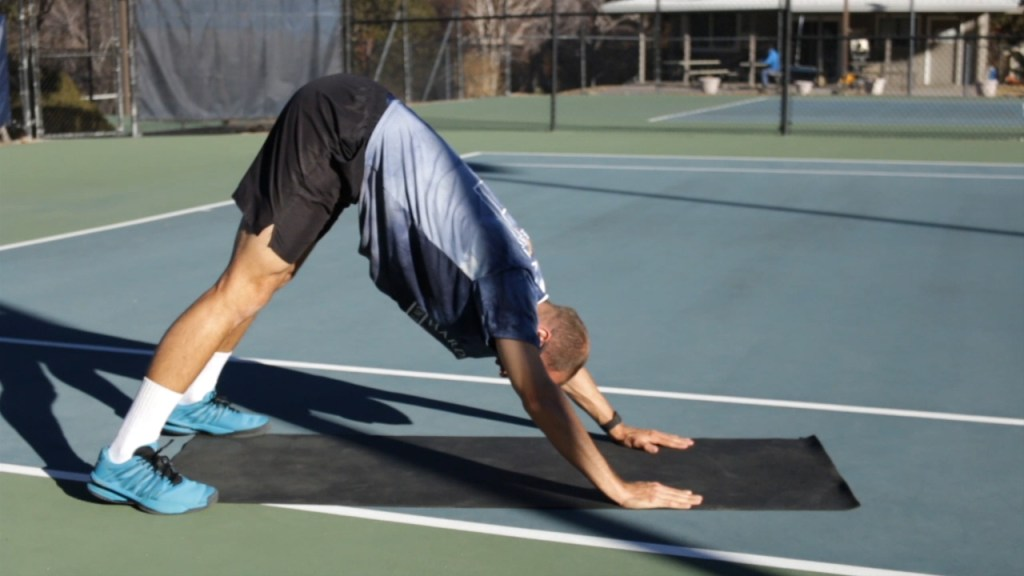 Downward dog stretch tennis post match