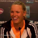 Wozniacki wins thriller over Sharapova at WTA Finals