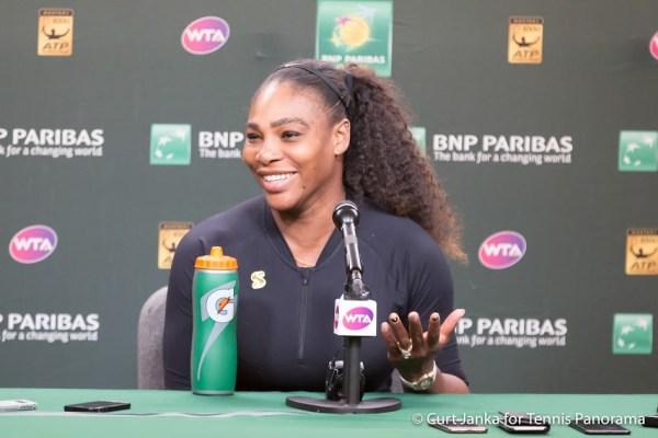 Serena smiles in press 382018