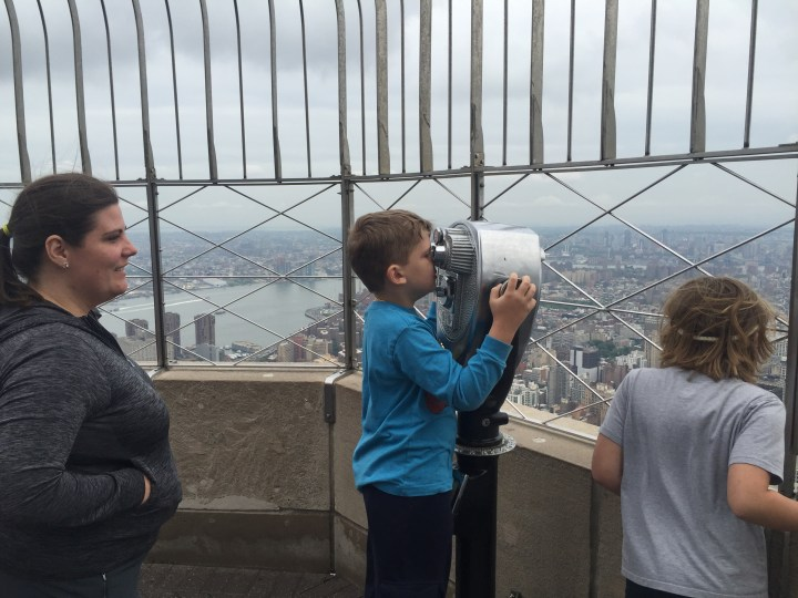Edward looks out over Manhattan from the top of the Empire State Building