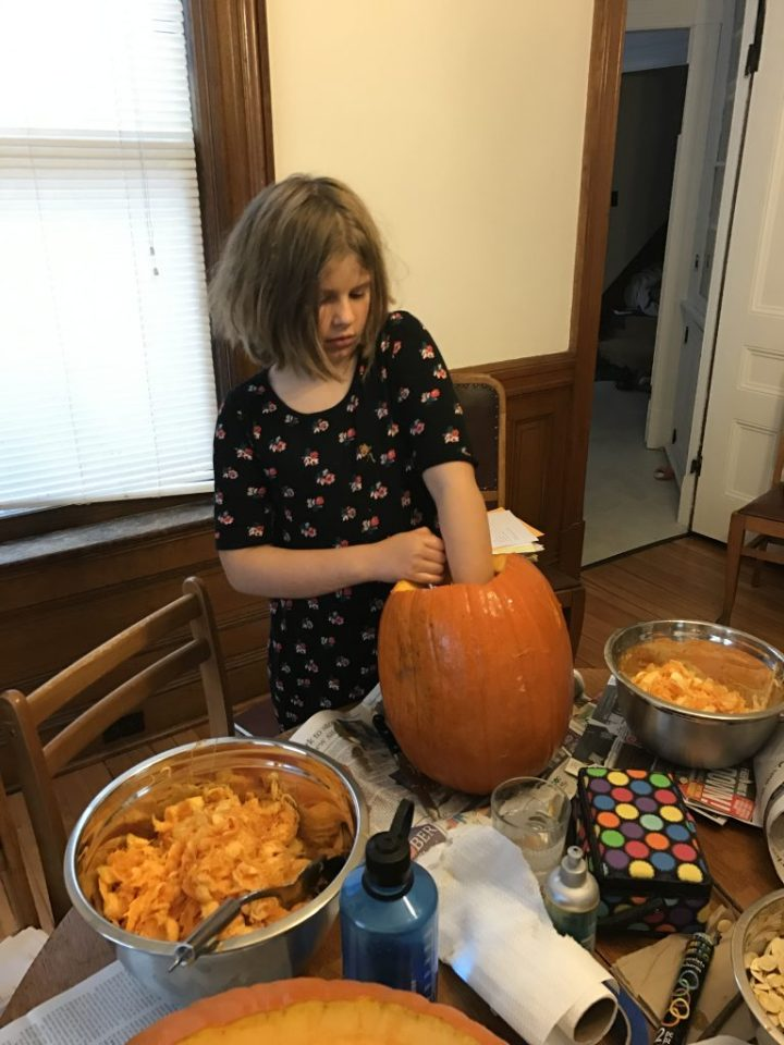 Ruby Carving her Pumpkin