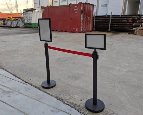 black queue pole with sign