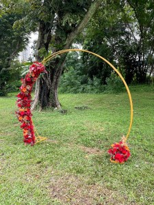 wedding arch with red flowers