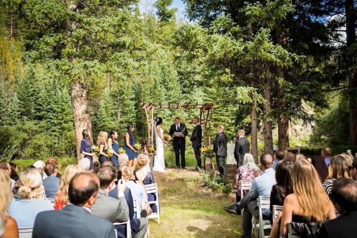Rustic Iron Wedding Arbor & White Garden Resin Ceremony Chairs