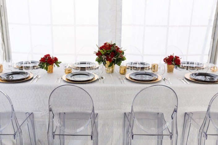 Modern Tablescape With Ghost Chairs, Round Black China & Stemless Wine Glasses