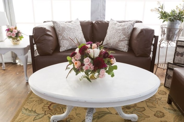 Pecan Axis Lounge Furniture With Antique White Clawfoot Tables