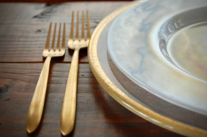 flatware rental- gold flatware gold rimmed charger and luster plates