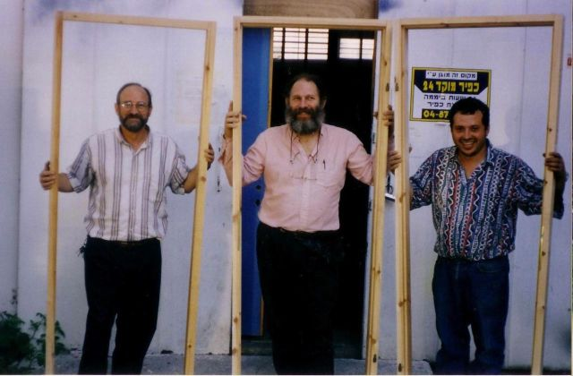 Eitan, Moshe, and Leon in front of the warehouse before the firebombing