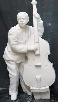 atlantic 1927: bass player  (FIG 249)  bisqueware