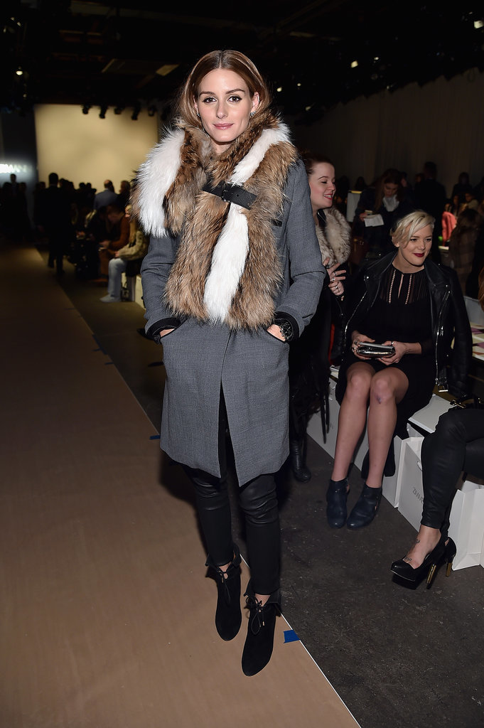 Olivia-sat-front-row-Zimmermann-armed-right-accessories