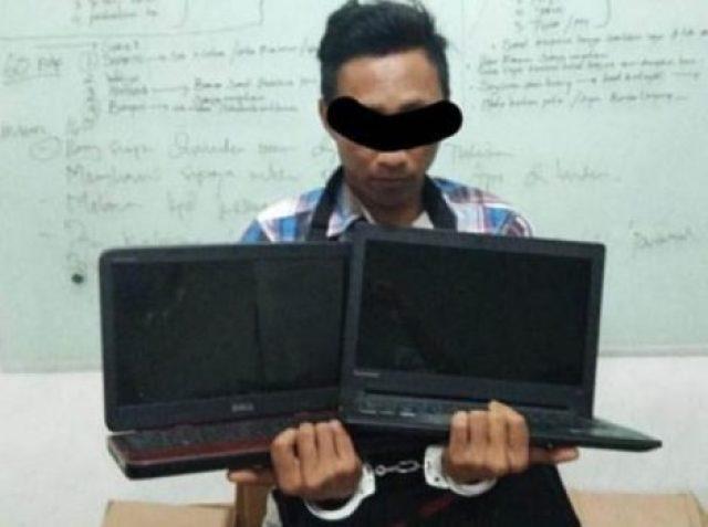Pelaku pembobol Warnet, SA (32) diamankan tim Tekab 308 Polres Lampung Selatan dan Polsek Kalianda bersama barang bukti laptop hasil curian. (Foto: Humas Polres Lamsel)