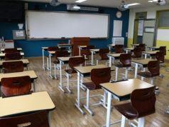 Ruang kelas di Korea Selatan kembali sepi, tanpa murid setelah pemerintah memutuskan sekolah harus ditutup lagi. Foto: Getty Images via BBC