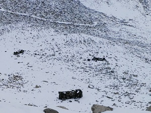 Army trucks knocked down in an avalanche