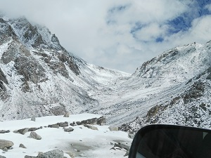Snow in the valley below Chang La Pass