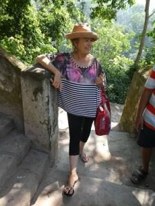 Phyllis on the steps near Vasuvistha Gufa Cave