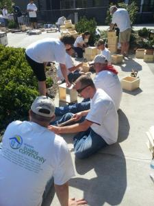 Aramark employees building garden boxes for residents of