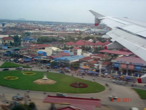First view of city, coming in to land at Phnom Penh airport, Cambodia 2011