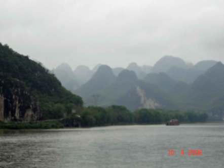 A-myriad-of-rounded-mountain shapes loomed at us from the mist of the river bank2