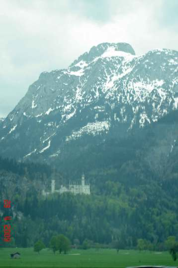 Neeuschwanstein and Alps from green pastures near Wieskirche