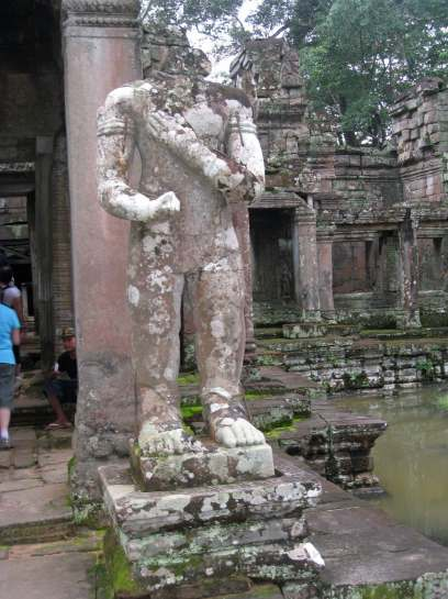 One of the two dvarapala guardian statues survives, though it is decapitated.