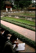 Art students drawing in the Temple of the Litterature. Hanoi, Vietnam