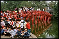 The romantic Huc bridge leading to Ngoc Son temple  in Hoan Kiem lake. Hanoi, Vietnam