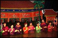 Artists salute after a water puppets performance. Hanoi, Vietnam