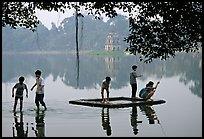 Children playing in Hoa Kiem Lake. Hanoi, Vietnam