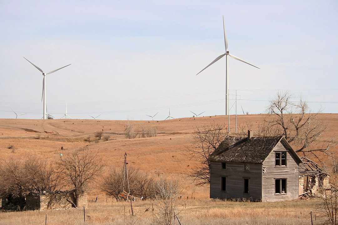 Abandoned farmhouse with turbines in background, Meridian Way Wind Farm, Cloud County, KS