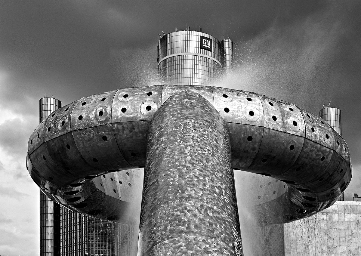 Dodge Fountain designed by Isamu Noguchi in Detroit's Hart Plaza and the top of the Renaissance Center