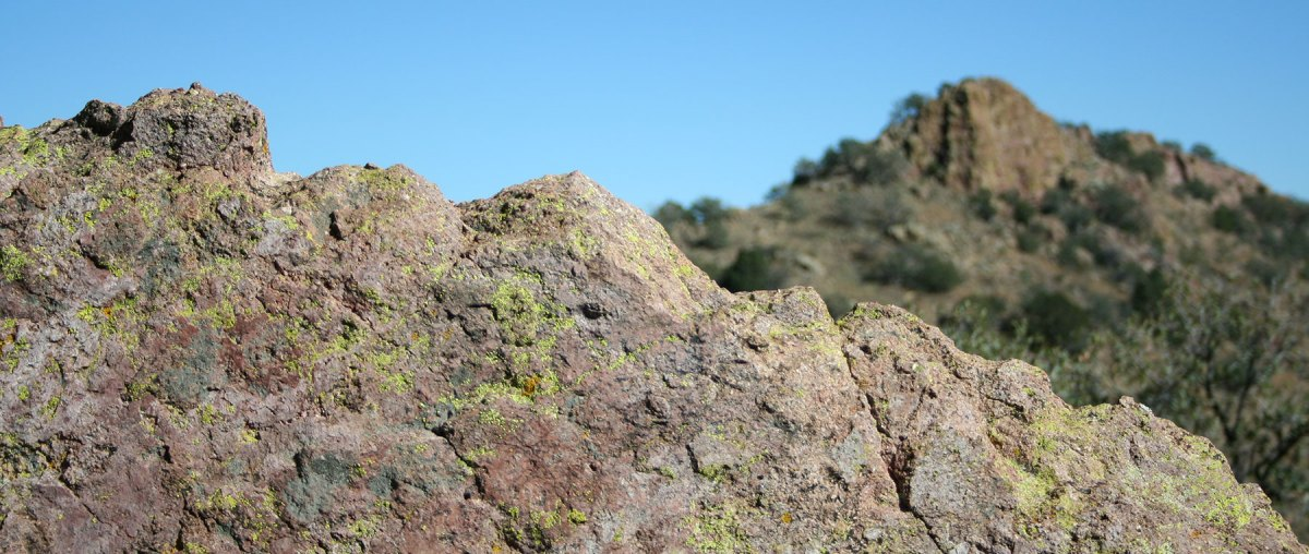 Granite rock with mountain in distance